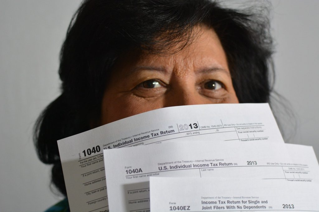 IRS form shown by a woman